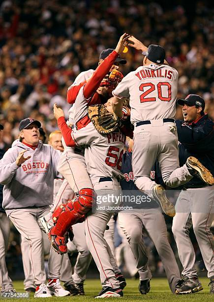 Curt Schilling Kevin Youkilis Jonathan Papelbon and Jason Varitek of the Boston Red Sox celebrate after winning Game Four by a score of the 43 to win...