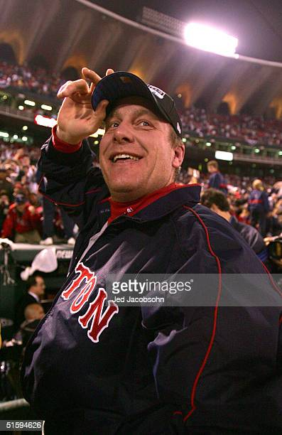 Curt Schilling of the Boston Red Sox celebrates after defeating the St Louis Cardinals 30 in game four of the World Series on October 27 2004 at...