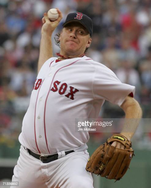 Curt Schilling of the Boston Red Sox delivers a pitch against the New York Mets on June 29 2006 at Fenway Park in Boston Massachusetts The Red Sox...