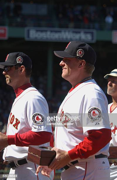 Curt Schilling of the Boston Red Sox stands on the field for the World Series championship ring presentation on Opening Day against the New York...