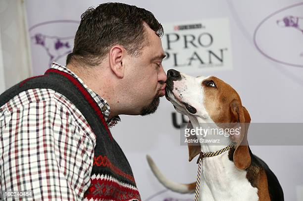 Curt Willis and his Treeing Walker Coonhound dog 'Tank' attend the The Westminster Kennel Club 137th Annual Dog Show Press Conference at Affinia on...