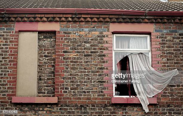 A curtain blowing in the wind is all that remains in one of the boarded up houses in Rhiwlas Street one of the 'Welsh Streets' in Toxteth March 21...