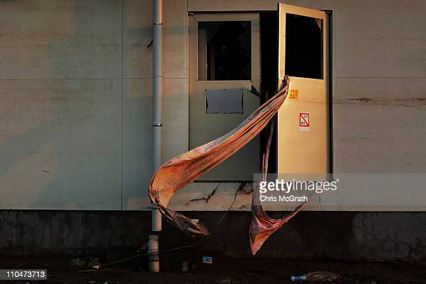 A curtain blows in the wind from the door of a hospital on March 19 2011 in Minamisanriku Japan Many people have begun to return to their homes as...