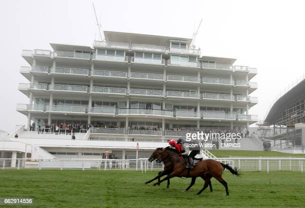 Curtain Call ridden by Jamie Spencer and Ladies Best ridden by Francesca Cumani go past the Queens Stand during their exercise on the track
