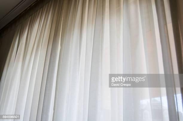 Curtain in breeze