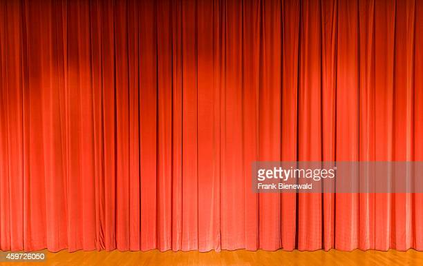 A curtain in light red color covering a theater stage