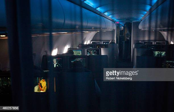 A curtain separates Business and First Class seats from the economy section on board an American Airlines A321 jet December 3 2014 over eastern...