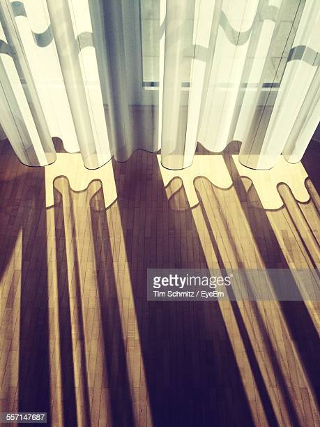 Curtains Casting Shadow On Floor