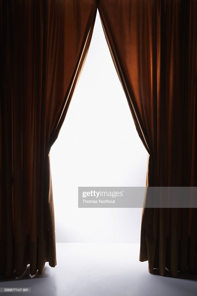 Curtains drawn back on stage : Stock Photo