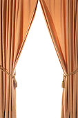 Curtains drawn back with tasseled curtain ties