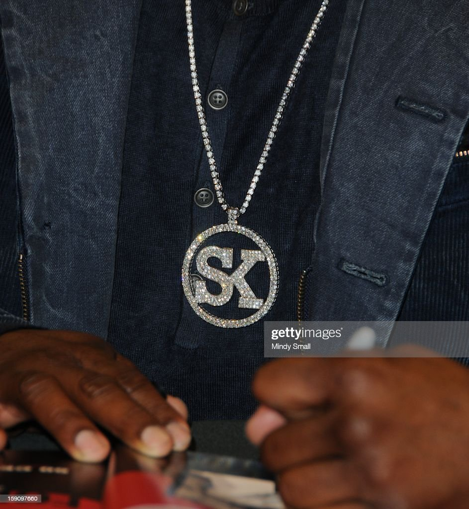Curtis '50 Cent' Jackson (necklace detail) signs copies of his book 'Formula 50' on January 7, 2013 in Las Vegas, Nevada.