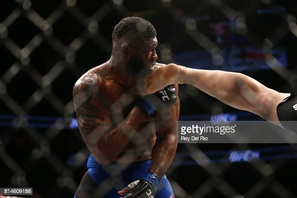 Curtis Blaydes is kicked by Daniel Omielanczuk in their heavyweight bout during the UFC 213 event at TMobile Arena on July 9 2017 in Las Vegas Nevada