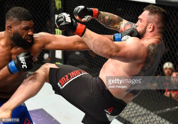Curtis Blaydes punches Daniel Omielanczuk of Poland in their heavyweight bout during the UFC 213 event at TMobile Arena on July 8 2017 in Las Vegas...