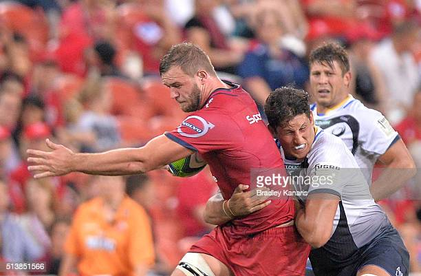 Curtis Browning of the Reds is tackled during the round two Super Rugby match between the Reds and the Force at Suncorp Stadium on March 5 2016 in...