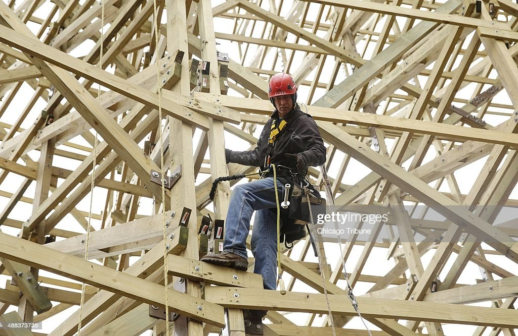 Curtis Clark works high up on the new Goliath coaster under construction at Six Flags Great American in Gurneee Ill on April 30 2014