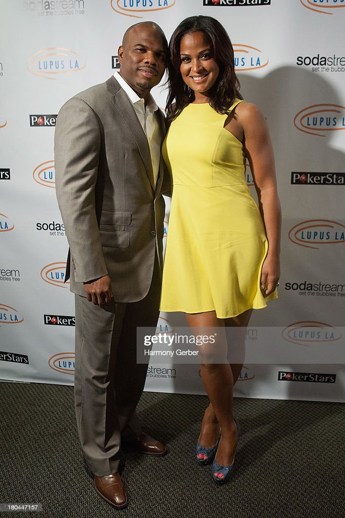 Curtis Conway and Laila Ali attend the Get Lucky For Lupus LA event at Peterson Automotive Museum on September 12 2013 in Los Angeles California