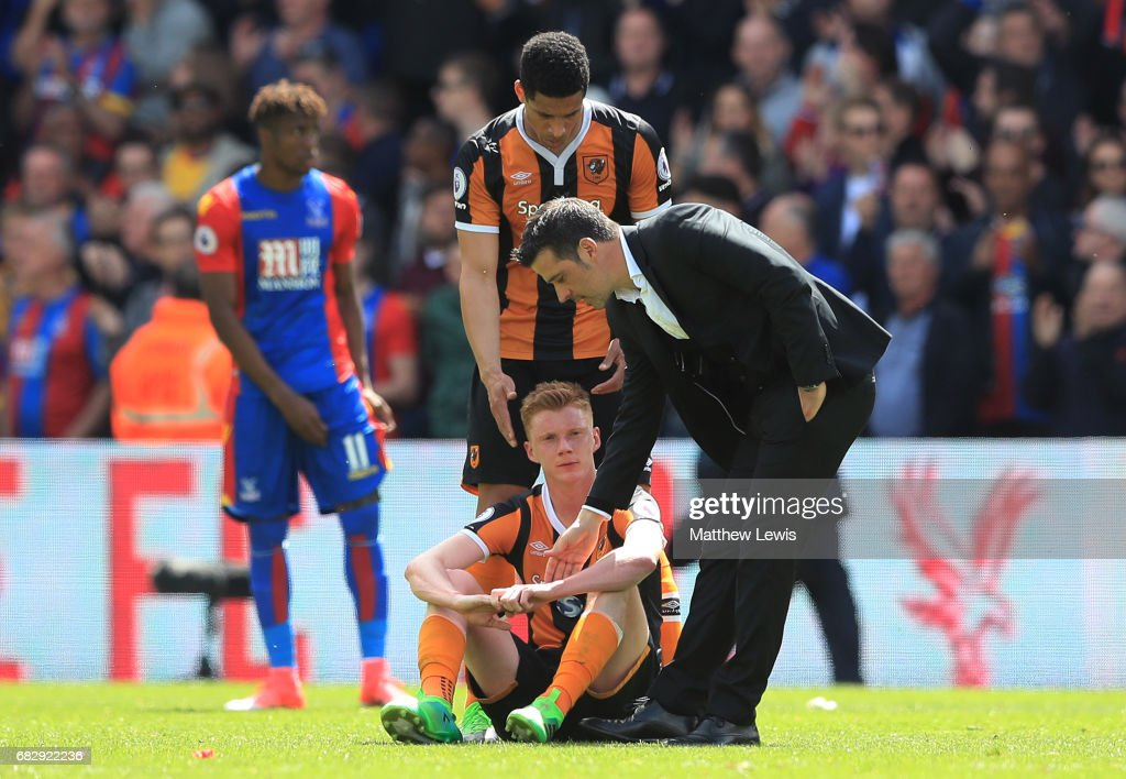 Curtis Davies of Hull City and Marco Silva manager of Hull City console Sam Clucas of Hull City as they are relegated to the Championship after the Premier League match between Crystal Palace and Hull City at Selhurst Park on May 14, 2017 in London, England.