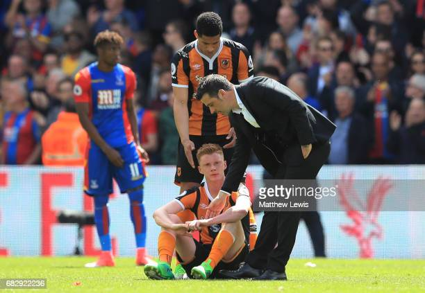 Curtis Davies of Hull City and Marco Silva manager of Hull City console Sam Clucas of Hull City as they are relegated to the Championship after the...