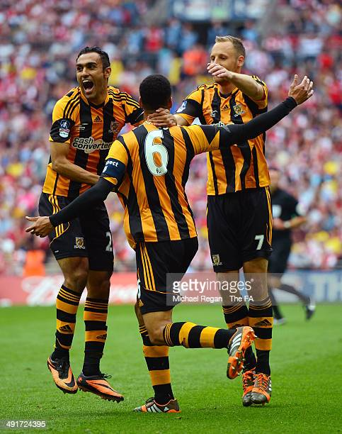 Curtis Davies of Hull City celebrates with teammates Ahmed Elmohamady of Hull City and David Meyler of Hull City after scoring his team's second goal...