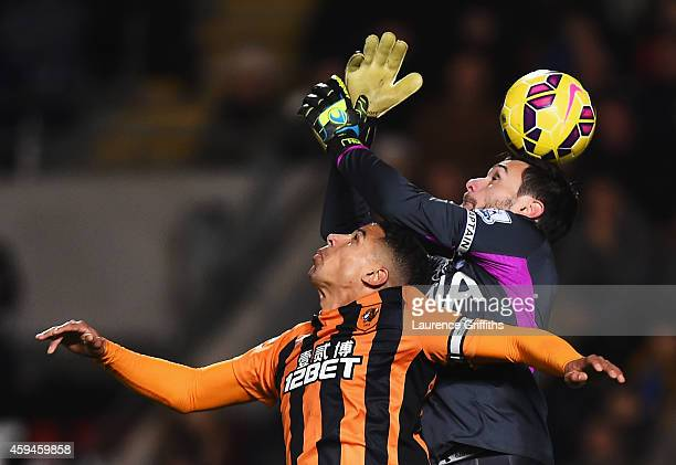 Curtis Davies of Hull City challenges Hugo Lloris of Tottenham Hotspur during the Barclays Premier League match between Hull City and Tottenham...