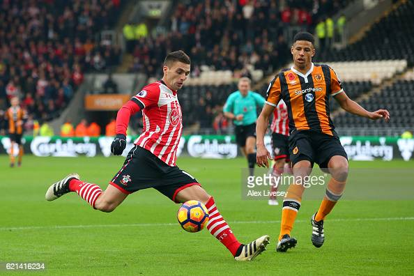 Curtis Davies of Hull City closes down Dusan Tadic of Southampton during the Premier League match between Hull City and Southampton at KC Stadium on...