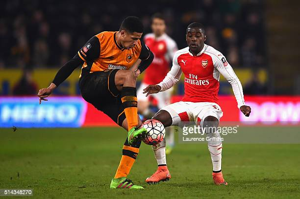 Curtis Davies of Hull City is closed down by Joel Campbell of Arsenal during the Emirates FA Cup Fifth Round Replay match between Hull City and...