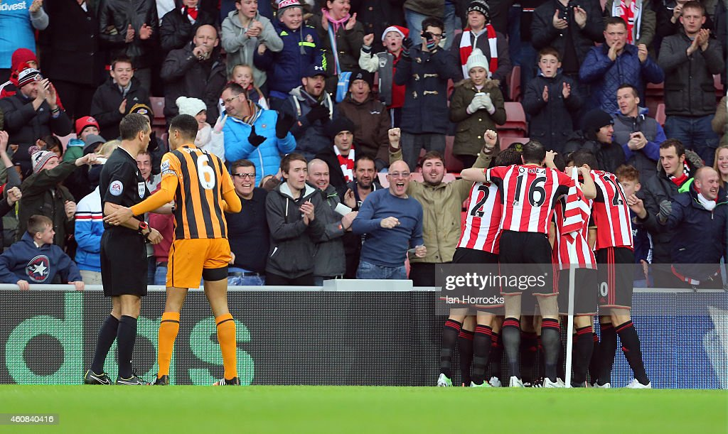Curtis Davis of Hull City argues with referee Andre Marriner after the first goal during the Barclays Premier League match between Sunderland and...