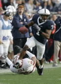 Curtis Drake of the Penn State Nittany Lions rushes the ball past Nick Polk of the Indiana Hoosiers at Beaver Stadium on November 14 2009 in State...