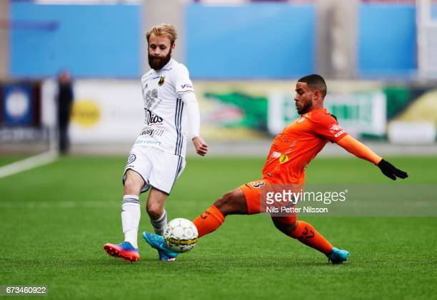 Curtis Edwards of Ostersunds FK and Jernade Mead of Athletic FC Eskilstuna competes for the ball during the Allsvenskan match between Athletic FC...