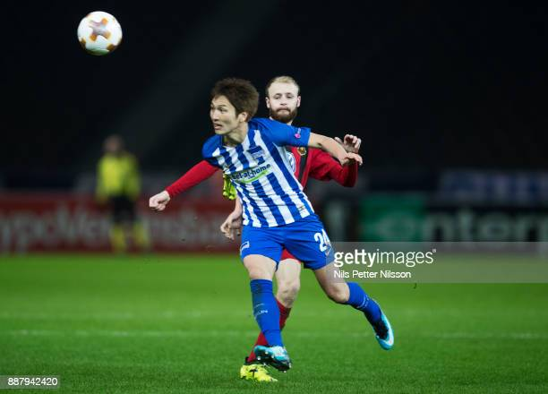 Curtis Edwards of Ostersunds FK kicks Genki Haraguchi of Herta Berlin SC during the UEFA Europa League group J match between Hertha BSC and...