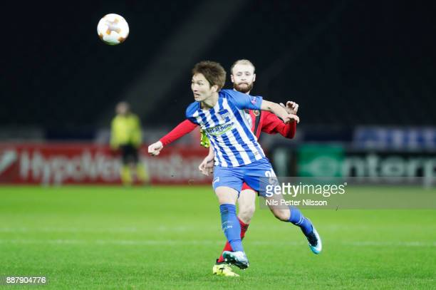 Curtis Edwards of Ostersunds FK kicks Genki Haraguchi of Hertha Berlin SC during the UEFA Europa League group J match between Hertha BSC and...