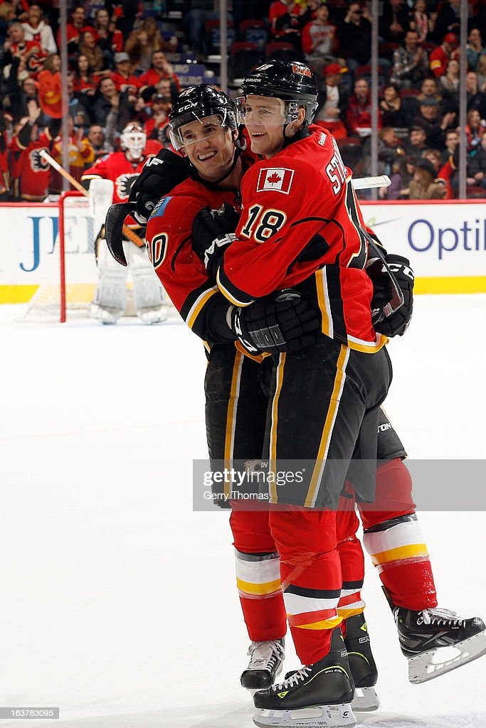 <a gi-track='captionPersonalityLinkClicked' href=/galleries/search?phrase=Curtis+Glencross&family=editorial&specificpeople=2190970 ng-click='$event.stopPropagation()'>Curtis Glencross</a> #20 and Matt Stajan #18 of the Calgary Flames celebrate a goal against the Nashville Predators on March 15, 2013 at the Scotiabank Saddledome in Calgary, Alberta, Canada.