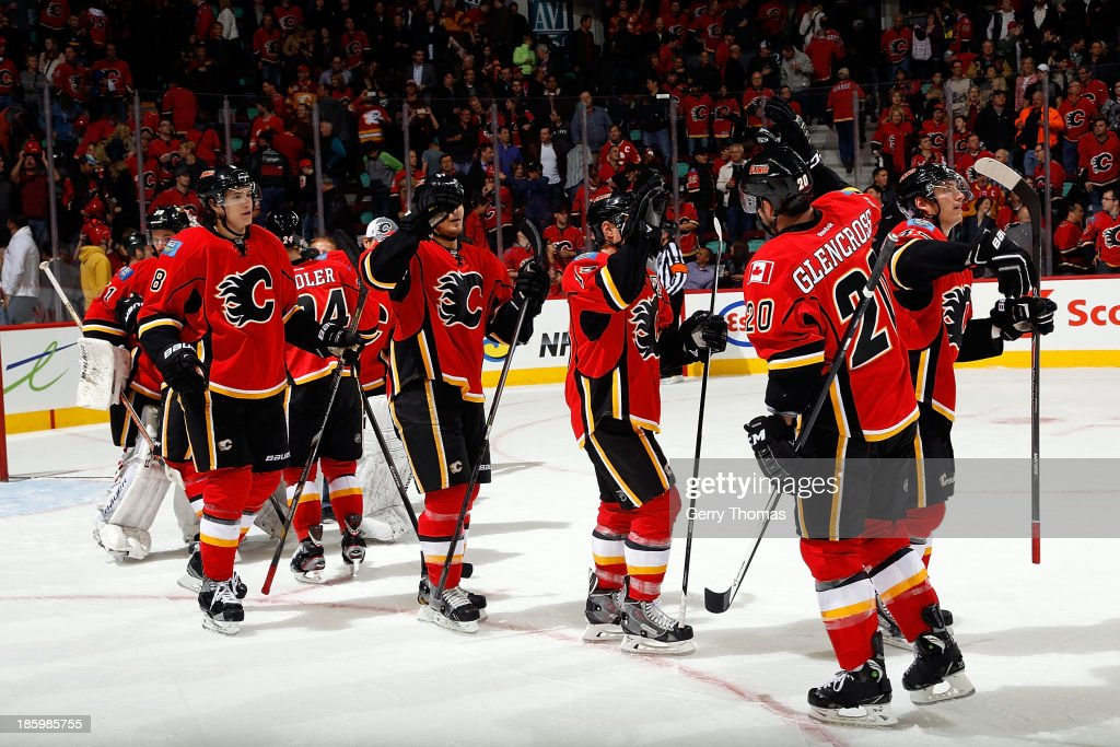 <a gi-track='captionPersonalityLinkClicked' href=/galleries/search?phrase=Curtis+Glencross&family=editorial&specificpeople=2190970 ng-click='$event.stopPropagation()'>Curtis Glencross</a> #20 and teammates of the Calgary Flames celebrate a win against the Washington Capitals at Scotiabank Saddledome on October 26, 2013 in Calgary, Alberta, Canada.
