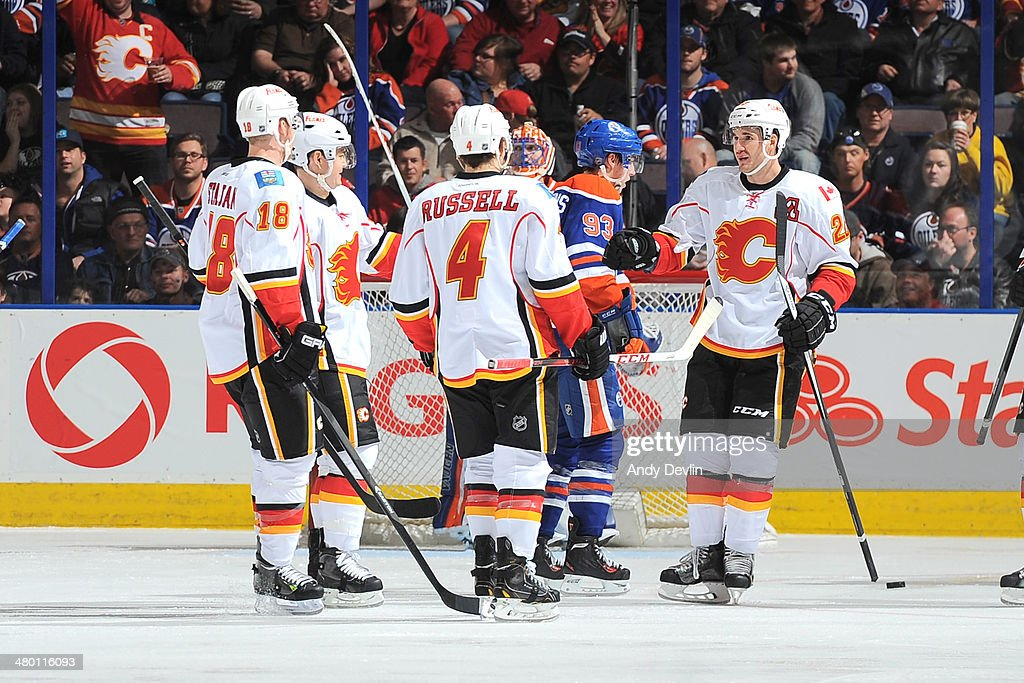 <a gi-track='captionPersonalityLinkClicked' href=/galleries/search?phrase=Curtis+Glencross&family=editorial&specificpeople=2190970 ng-click='$event.stopPropagation()'>Curtis Glencross</a> #20, <a gi-track='captionPersonalityLinkClicked' href=/galleries/search?phrase=Kris+Russell&family=editorial&specificpeople=879805 ng-click='$event.stopPropagation()'>Kris Russell</a> #4, Matt Stajan #18, and <a gi-track='captionPersonalityLinkClicked' href=/galleries/search?phrase=Jiri+Hudler&family=editorial&specificpeople=2118675 ng-click='$event.stopPropagation()'>Jiri Hudler</a> #24 of the Calgary Flames celebrate after a goal in a game against the Edmonton Oilers on March 22, 2014 at Rexall Place in Edmonton, Alberta, Canada.