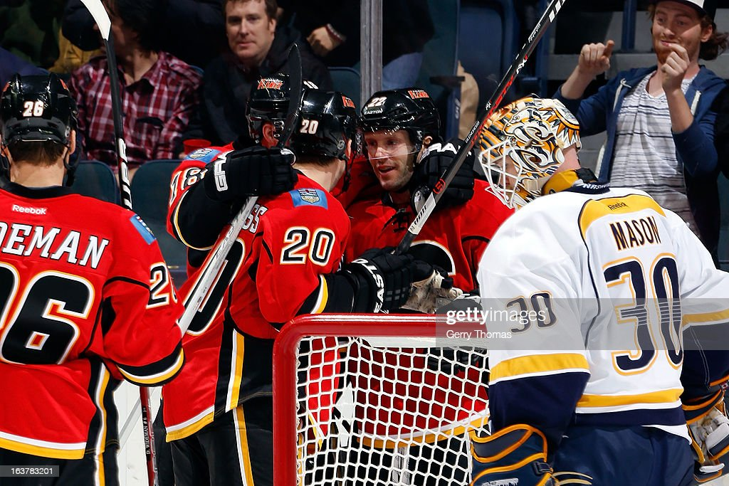 <a gi-track='captionPersonalityLinkClicked' href=/galleries/search?phrase=Curtis+Glencross&family=editorial&specificpeople=2190970 ng-click='$event.stopPropagation()'>Curtis Glencross</a> #20, <a gi-track='captionPersonalityLinkClicked' href=/galleries/search?phrase=Lee+Stempniak&family=editorial&specificpeople=575240 ng-click='$event.stopPropagation()'>Lee Stempniak</a> #22 and teammates of the Calgary Flames celebrate a goal against the Nashville Predators on March 15, 2013 at the Scotiabank Saddledome in Calgary, Alberta, Canada.