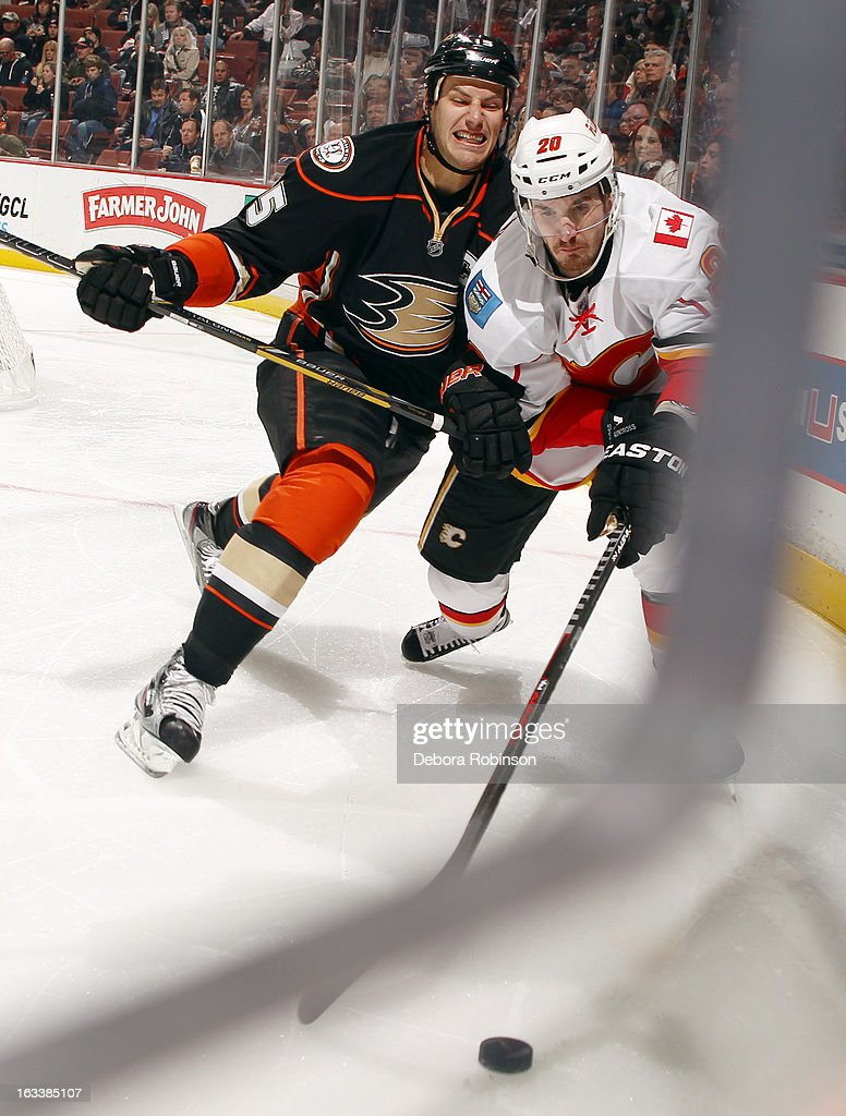 <a gi-track='captionPersonalityLinkClicked' href=/galleries/search?phrase=Curtis+Glencross&family=editorial&specificpeople=2190970 ng-click='$event.stopPropagation()'>Curtis Glencross</a> #20 of the Calgary Flames battles for the puck against <a gi-track='captionPersonalityLinkClicked' href=/galleries/search?phrase=Ryan+Getzlaf&family=editorial&specificpeople=602655 ng-click='$event.stopPropagation()'>Ryan Getzlaf</a> #15 of the Anaheim Ducks on March 8, 2013 at Honda Center in Anaheim, California.