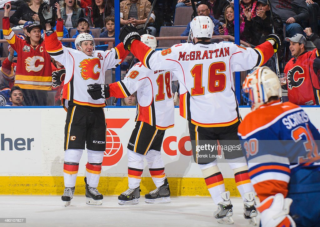 <a gi-track='captionPersonalityLinkClicked' href=/galleries/search?phrase=Curtis+Glencross&family=editorial&specificpeople=2190970 ng-click='$event.stopPropagation()'>Curtis Glencross</a> #20 of the Calgary Flames celebrates after scoring a hat trick against the Edmonton Oilers during an NHL game at Rexall Place on March 22, 2014 in Edmonton, Alberta, Canada. The Flames defeated the Oilers 8-1.