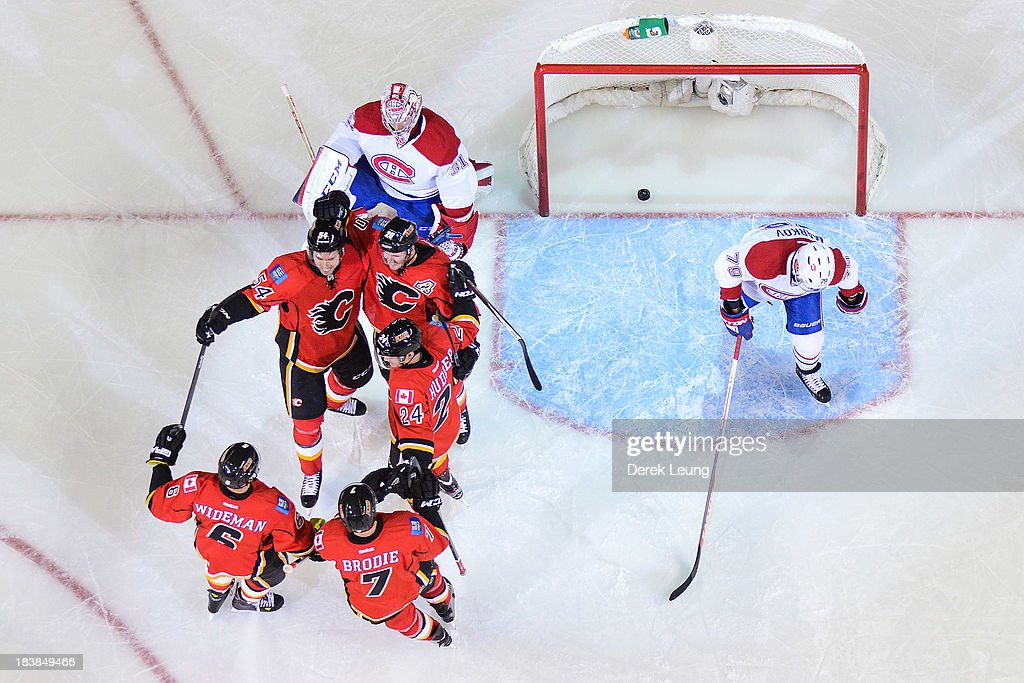 <a gi-track='captionPersonalityLinkClicked' href=/galleries/search?phrase=Curtis+Glencross&family=editorial&specificpeople=2190970 ng-click='$event.stopPropagation()'>Curtis Glencross</a> #20 of the Calgary Flames celebrates along with his teammates David Jones #54, Jiri Hudler #24, <a gi-track='captionPersonalityLinkClicked' href=/galleries/search?phrase=Dennis+Wideman&family=editorial&specificpeople=575234 ng-click='$event.stopPropagation()'>Dennis Wideman</a> #6, and T.J. Brodie #7 after scoring a goal on <a gi-track='captionPersonalityLinkClicked' href=/galleries/search?phrase=Carey+Price&family=editorial&specificpeople=2222083 ng-click='$event.stopPropagation()'>Carey Price</a> #31 of the Montreal Canadiens during an NHL game at Scotiabank Saddledome on October 9, 2013 in Calgary, Alberta, Canada. The Calgary Flames defeated the Montreal Canadiens 3-2.