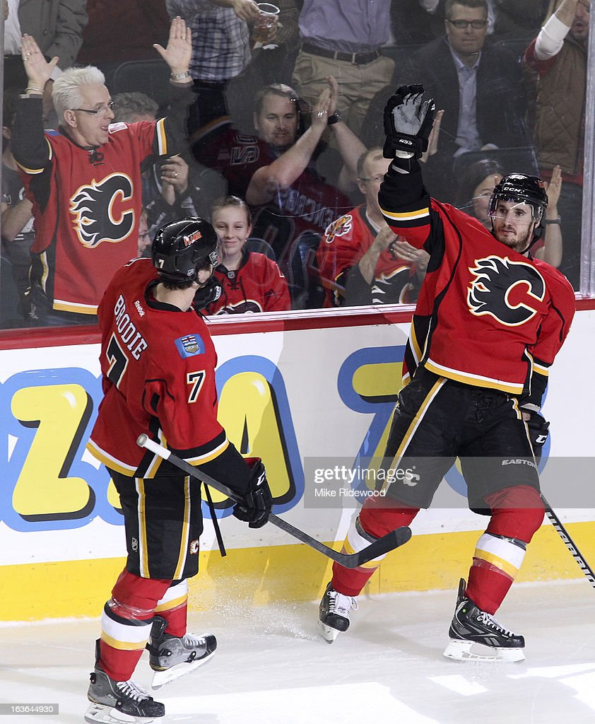 <a gi-track='captionPersonalityLinkClicked' href=/galleries/search?phrase=Curtis+Glencross&family=editorial&specificpeople=2190970 ng-click='$event.stopPropagation()'>Curtis Glencross</a> #20 of the Calgary Flames celebrates his goal with teammate TJ Brodie #7 against the Detroit Red Wings during third period NHL action on March 13, 2013 at the Scotiabank Saddledome in Calgary, Alberta, Canada. Calgary Flames defeated the Detroit Red Wings 5 - 2.