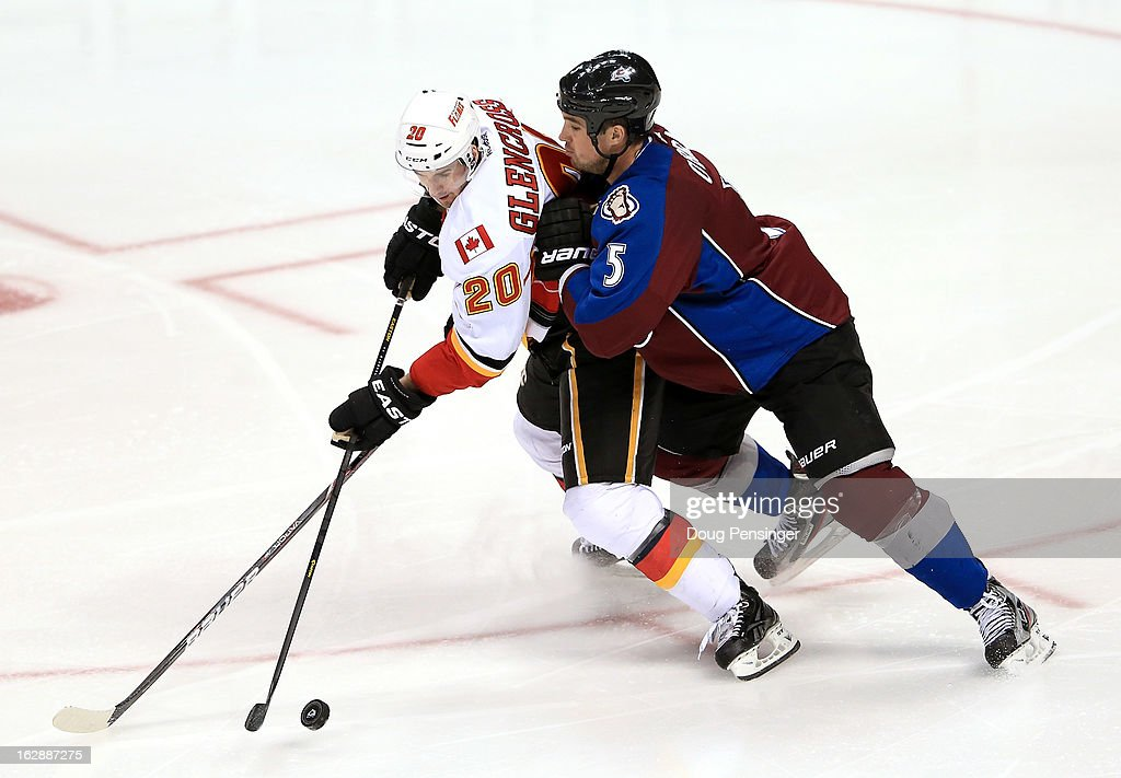 <a gi-track='captionPersonalityLinkClicked' href=/galleries/search?phrase=Curtis+Glencross&family=editorial&specificpeople=2190970 ng-click='$event.stopPropagation()'>Curtis Glencross</a> #20 of the Calgary Flames controls the puck while under pressure from <a gi-track='captionPersonalityLinkClicked' href=/galleries/search?phrase=Shane+O%27Brien&family=editorial&specificpeople=2190942 ng-click='$event.stopPropagation()'>Shane O'Brien</a> #5 of the Colorado Avalanche at the Pepsi Center on February 28, 2013 in Denver, Colorado. The Avalanche defeated the Flames 5-4.