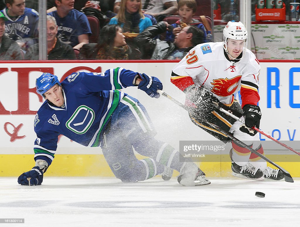 <a gi-track='captionPersonalityLinkClicked' href=/galleries/search?phrase=Curtis+Glencross&family=editorial&specificpeople=2190970 ng-click='$event.stopPropagation()'>Curtis Glencross</a> #20 of the Calgary Flames evades <a gi-track='captionPersonalityLinkClicked' href=/galleries/search?phrase=Dale+Weise&family=editorial&specificpeople=5527418 ng-click='$event.stopPropagation()'>Dale Weise</a> #32 of the Vancouver Canucks during their NHL game at Rogers Arena February 9, 2013 in Vancouver, British Columbia, Canada.