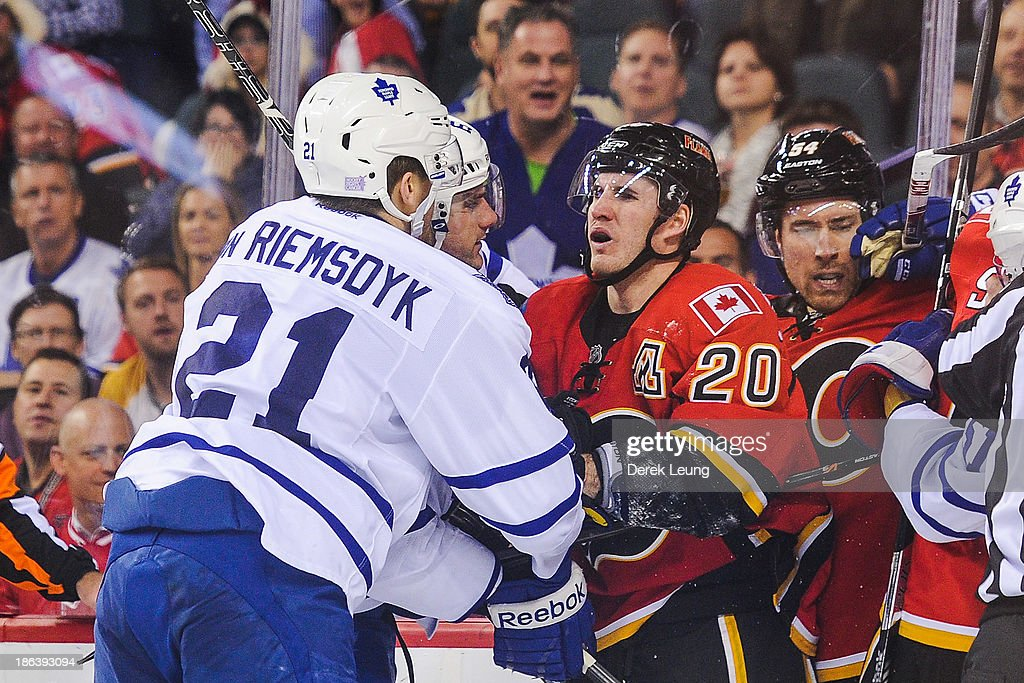 <a gi-track='captionPersonalityLinkClicked' href=/galleries/search?phrase=Curtis+Glencross&family=editorial&specificpeople=2190970 ng-click='$event.stopPropagation()'>Curtis Glencross</a> #20 of the Calgary Flames exchanges words with James van Riemsdyk #21 of the Toronto Maple Leafs during an NHL game at Scotiabank Saddledome on October 30, 2013 in Calgary, Alberta, Canada.