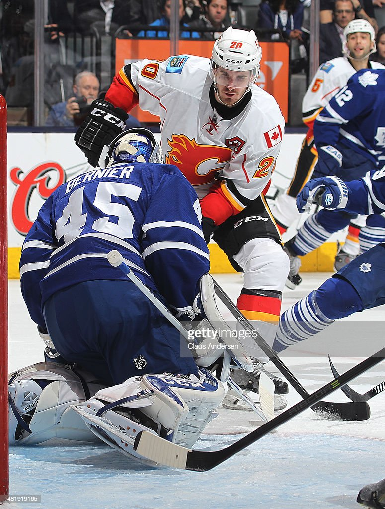 Curtis Glencross #20 of the Calgary Flames is stopped by Jonathan Bernier #45 of the Toronto Maple Leafs during an NHL game at the Air Canada Centre on April 1, 2014 in Toronto, Ontario, Canada. The Leafs defeated the Flames 3-2.