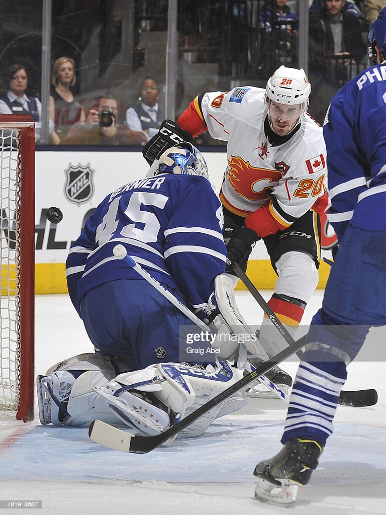 <a gi-track='captionPersonalityLinkClicked' href=/galleries/search?phrase=Curtis+Glencross&family=editorial&specificpeople=2190970 ng-click='$event.stopPropagation()'>Curtis Glencross</a> #20 of the Calgary Flames is stopped in close by <a gi-track='captionPersonalityLinkClicked' href=/galleries/search?phrase=Jonathan+Bernier&family=editorial&specificpeople=540491 ng-click='$event.stopPropagation()'>Jonathan Bernier</a> #45 of the Toronto Maple Leafs during NHL game action April 1, 2014 at the Air Canada Centre in Toronto, Ontario, Canada.