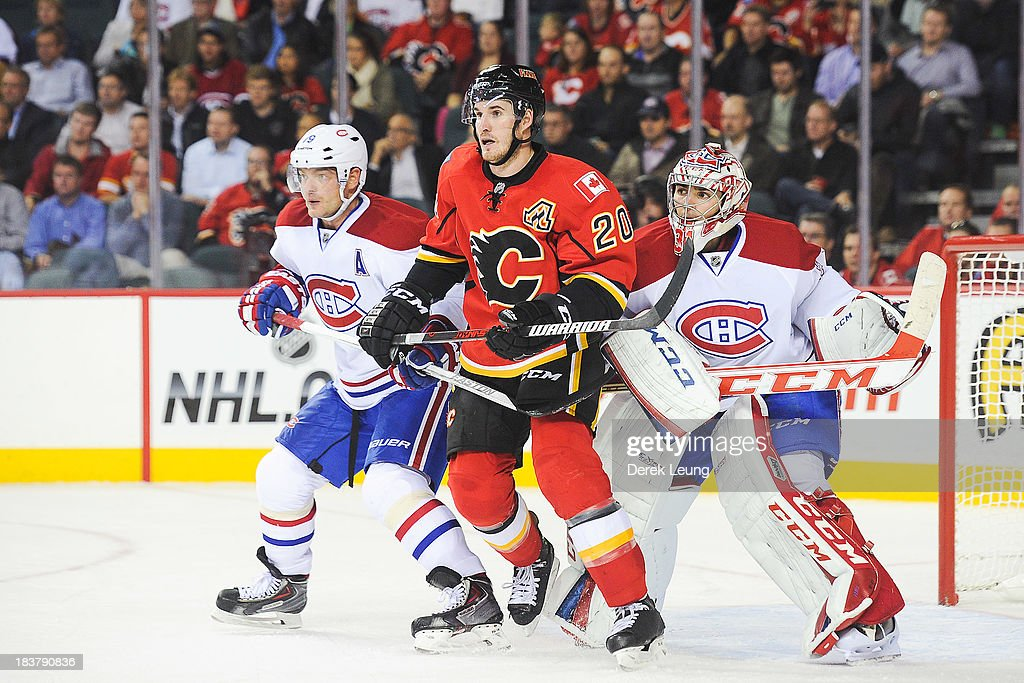 <a gi-track='captionPersonalityLinkClicked' href=/galleries/search?phrase=Curtis+Glencross&family=editorial&specificpeople=2190970 ng-click='$event.stopPropagation()'>Curtis Glencross</a> #20 of the Calgary Flames looks for an opportunity in front of the net as <a gi-track='captionPersonalityLinkClicked' href=/galleries/search?phrase=Andrei+Markov&family=editorial&specificpeople=204528 ng-click='$event.stopPropagation()'>Andrei Markov</a> #79 (L) and <a gi-track='captionPersonalityLinkClicked' href=/galleries/search?phrase=Carey+Price&family=editorial&specificpeople=2222083 ng-click='$event.stopPropagation()'>Carey Price</a> #31 (R) of the Montreal Canadiens defend during an NHL game at Scotiabank Saddledome on October 9, 2013 in Calgary, Alberta, Canada. The Calgary Flames defeated the Montreal Canadiens 3-2.