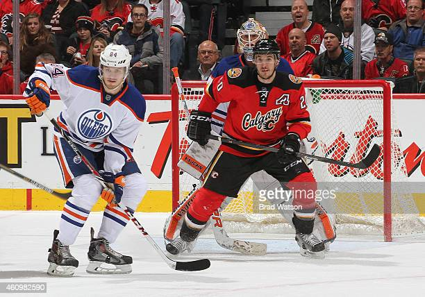 Curtis Glencross of the Calgary Flames skates against Oscar Klefbom of the Edmonton Oilers at Scotiabank Saddledome on December 27 2014 in Calgary...