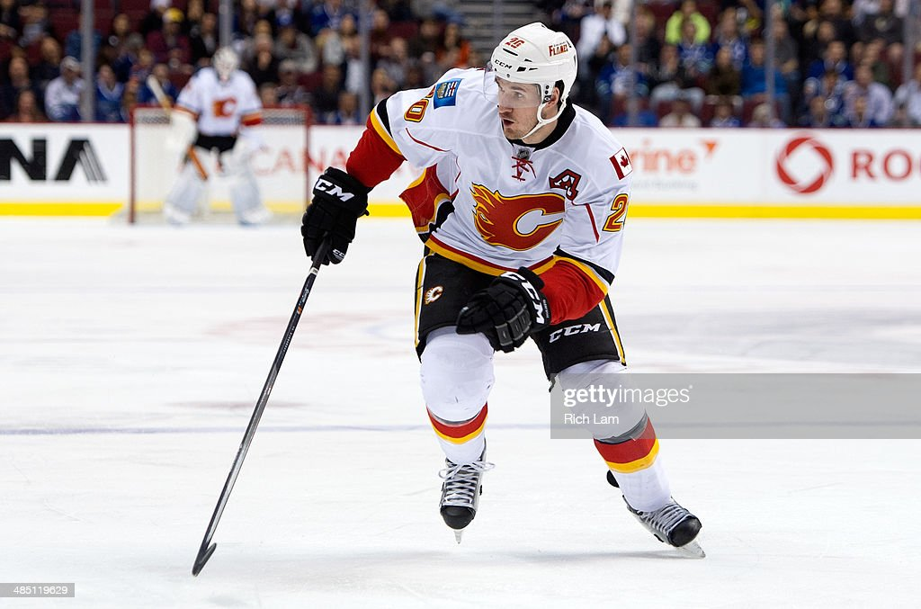 Curtis Glencross #20 of the Calgary Flames skates during NHL action against the Vancouver Canucks on April 13, 2014 at Rogers Arena in Vancouver, British Columbia, Canada.