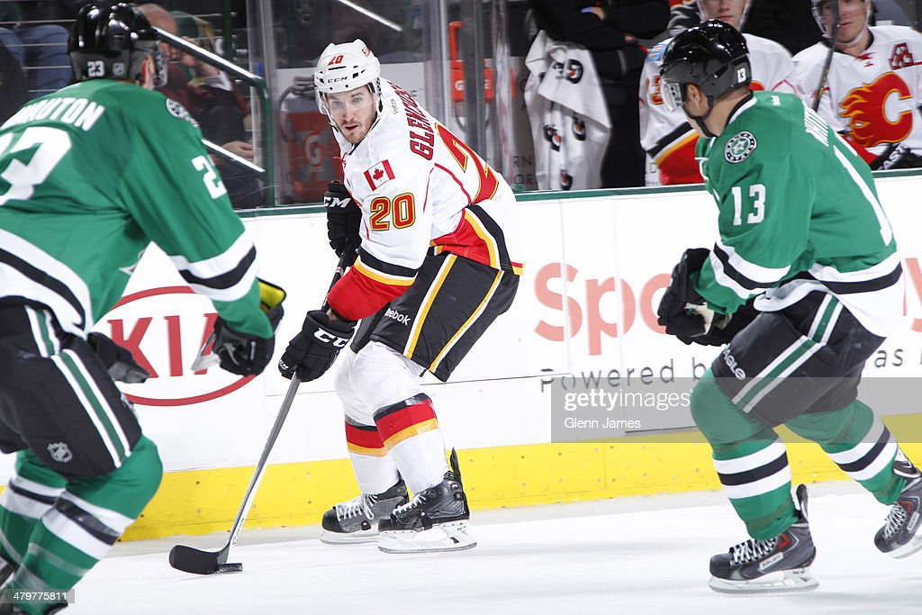 <a gi-track='captionPersonalityLinkClicked' href=/galleries/search?phrase=Curtis+Glencross&family=editorial&specificpeople=2190970 ng-click='$event.stopPropagation()'>Curtis Glencross</a> #20 of the Calgary Flames tries to keep the puck away against <a gi-track='captionPersonalityLinkClicked' href=/galleries/search?phrase=Kevin+Connauton&family=editorial&specificpeople=6271014 ng-click='$event.stopPropagation()'>Kevin Connauton</a> #23 and <a gi-track='captionPersonalityLinkClicked' href=/galleries/search?phrase=Ray+Whitney&family=editorial&specificpeople=202090 ng-click='$event.stopPropagation()'>Ray Whitney</a> #13 of the Dallas Stars at the American Airlines Center on March 14, 2014 in Dallas, Texas.