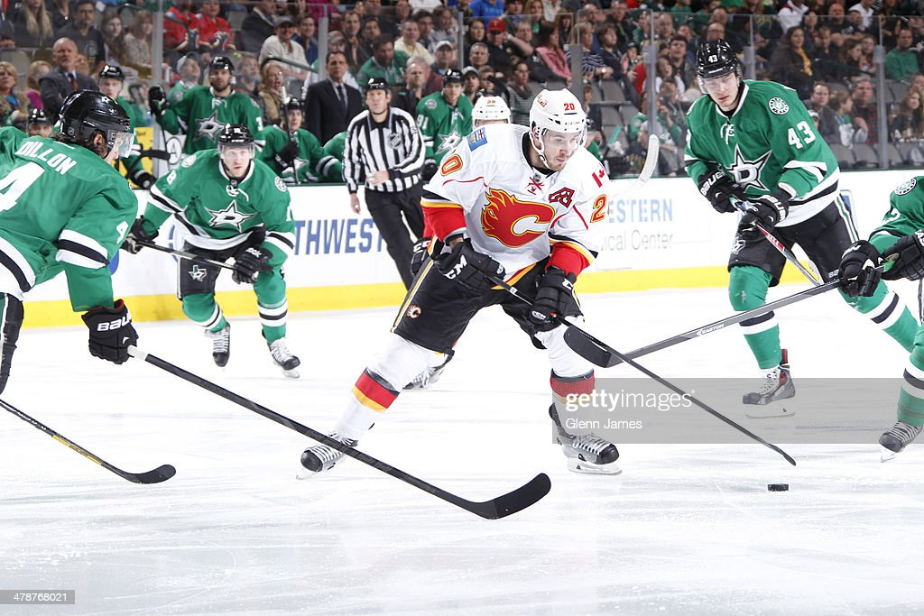 <a gi-track='captionPersonalityLinkClicked' href=/galleries/search?phrase=Curtis+Glencross&family=editorial&specificpeople=2190970 ng-click='$event.stopPropagation()'>Curtis Glencross</a> #20 of the Calgary Flames weaves his way through the defense against <a gi-track='captionPersonalityLinkClicked' href=/galleries/search?phrase=Brenden+Dillon&family=editorial&specificpeople=6254216 ng-click='$event.stopPropagation()'>Brenden Dillon</a> #4 of the Dallas Stars at the American Airlines Center on March 14, 2014 in Dallas, Texas.