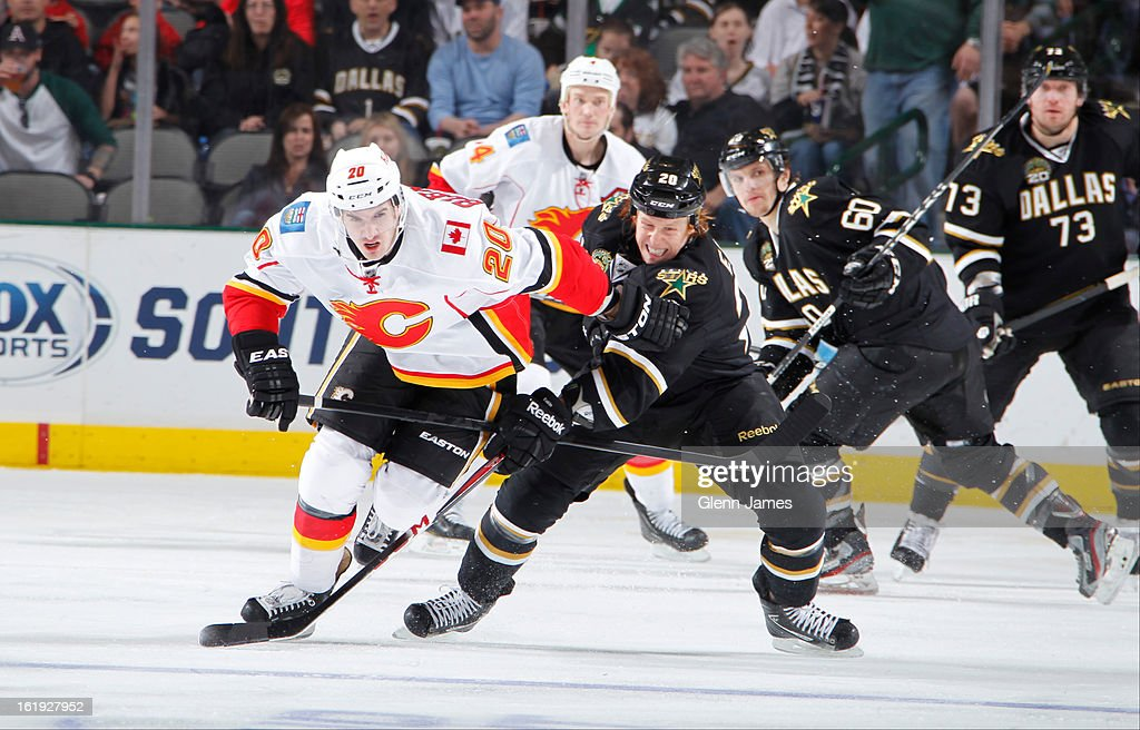 Curtis Glenncross #20 of the Calgary Flames tries to keep the puck away against <a gi-track='captionPersonalityLinkClicked' href=/galleries/search?phrase=Cody+Eakin&family=editorial&specificpeople=5662792 ng-click='$event.stopPropagation()'>Cody Eakin</a> #20 of the Dallas Stars at the American Airlines Center on February 17, 2013 in Dallas, Texas.